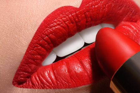 Sensual open mouth  with red tube of lipstick Macro shot of evening make up lips