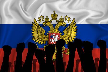 Photo pour Silhouette of raised arms and clenched fists on the background of the flag of Russia. The concept of power, power, conflict. With place for your text. - image libre de droit