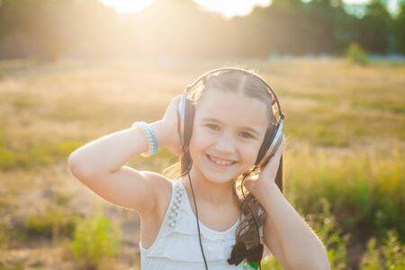 happy girl listening music with headphones