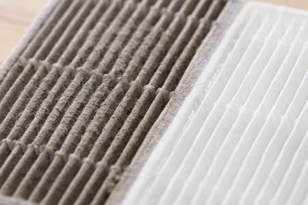 Photo pour new and dirty air filter for robot vacuum cleaner - image libre de droit