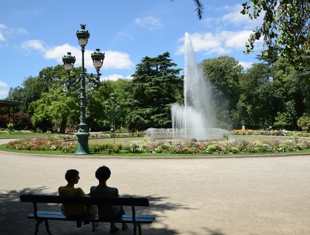 Women are resting on the bench in the shadow of the city park  Jardin du Grand-Rond  in Toulouse