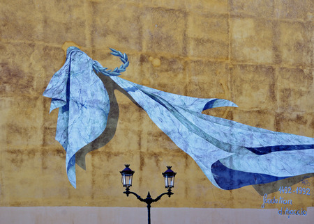 A modern mural of the blue cloth on the ancient wall in the Corsican city Ajaccio.