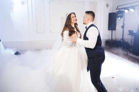 Foto für Beautiful wedding couple just married and dancing their first dance - Lizenzfreies Bild