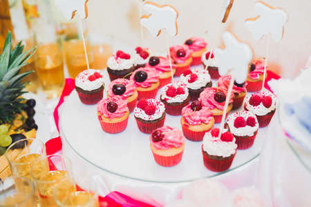 Photo for Delicious and tasty dessert table with cupcakes shots at reception closeup - Royalty Free Image