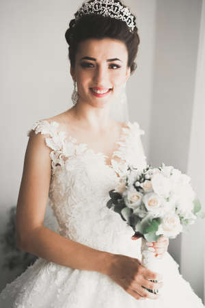 Photo for Portrait of stunning bride with long hair posing with great bouquet - Royalty Free Image