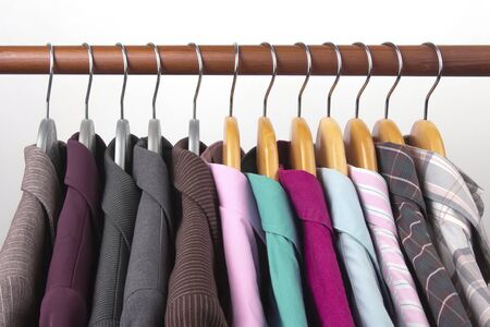 Photo pour Different women's office classic jackets and shirts hang on a hanger for storing clothes. The choice of style of fashionable clothes - image libre de droit
