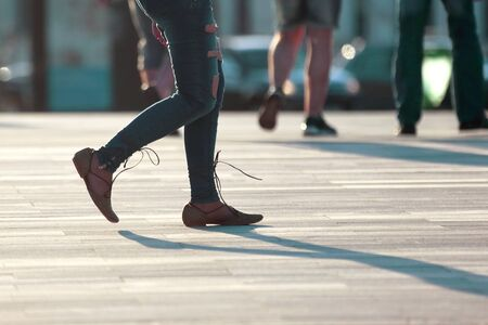 Photo for walking women legs in backlight sunlight - Royalty Free Image