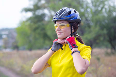 Photo for Beautiful and happy girl cyclist on nature. Healthy lifestyle and sports. Leisure and hobbies - Royalty Free Image