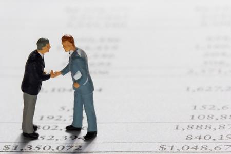 Miniature businessmans on report  Business concept