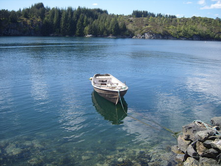 boat, at the mooring end, calm, blue water, rocks, transparent, fjords,