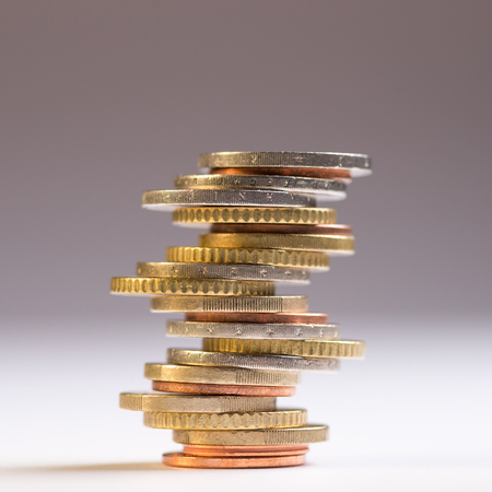 Photo pour Euro coins stacked on each other in different positions. Copy space for text - image libre de droit
