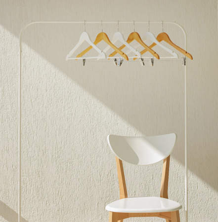 Foto per White row of hangers on the rack. Selective focus - Immagine Royalty Free