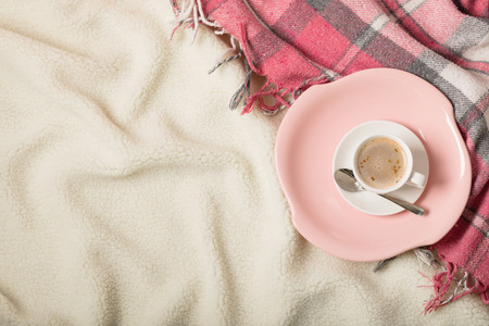Photo pour Winter time. A cozy warm pink blanket and a cup of coffee and croissants on the bed. Selective focus. - image libre de droit