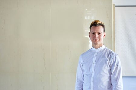 Photo pour portrait of a young guy with dyed hair in a white shirt - image libre de droit