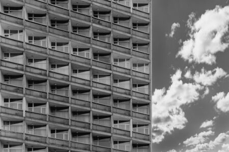 Photo pour Top view of block of flats from bottom. Standardized apartments, housing, hotel. Black and white shot of architecture. - image libre de droit
