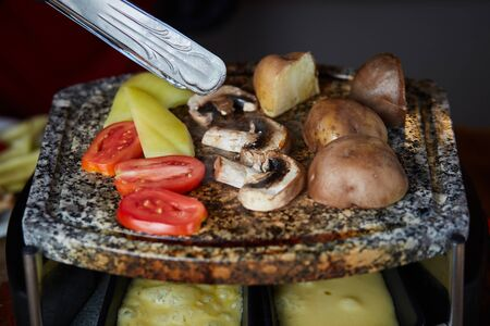 Photo for Swiss raclette. A table filled with ingredients. - Royalty Free Image