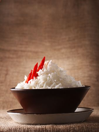 rice bowl with fresh chillies on brown rustic background, Low Key Lighting Technique, Shallow DOF