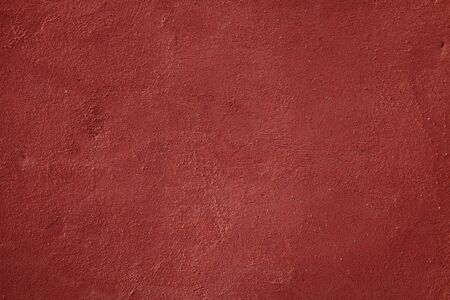 Old plaster wall texture background in Ochre City Marrakech, Morocco