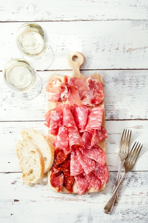 Platter of serrano jamon Cured Meat and ciabattaの写真素材