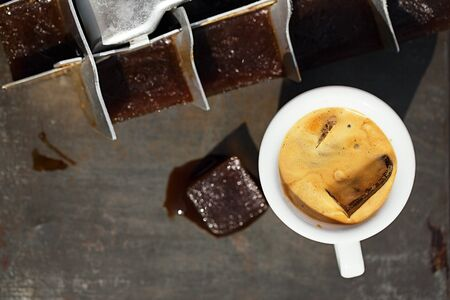 espresso with ice cubes coffee and vintage ice cube tray