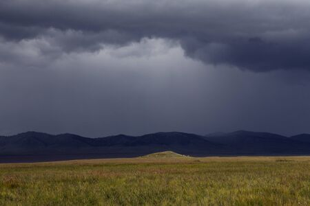 Rain front extending over the steppe. Khakassia. Russia.