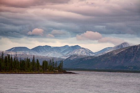 Clouds over the mountains and big lake. Lake Labynkyr. Yakutia. Russia.