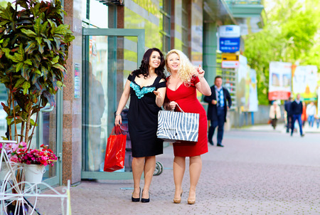 happy plus size women shoppingの写真素材
