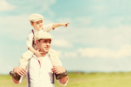 Photo pour portrait of father and son in the countryside - image libre de droit