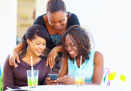 happy african friends chatting in social networkの写真素材
