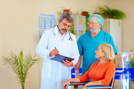 doctor and surgeon consulting patient about medication