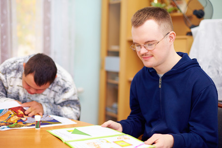 Photo pour young adult man engages in self study, in rehabilitation center - image libre de droit