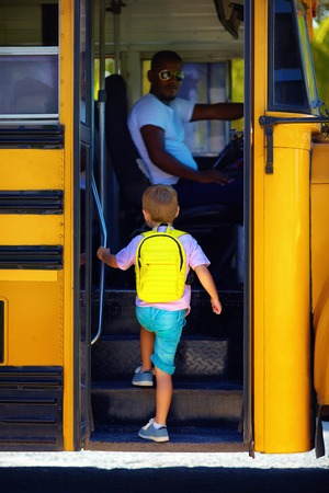 Photo pour cute kid are getting on the bus, ready to go to school - image libre de droit