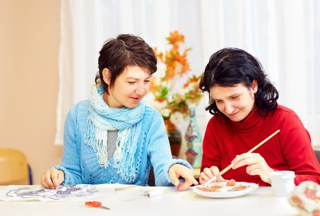 Photo pour adult woman with special needs are engaged in handcraft in rehabilitation center - image libre de droit