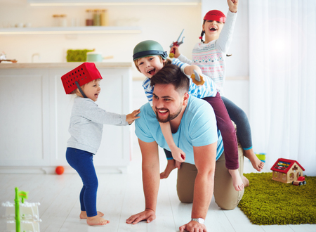 Photo for happy family playing together at home, riding on father - Royalty Free Image