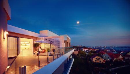 Photo pour family relaxing on roof top patio with evening city view - image libre de droit