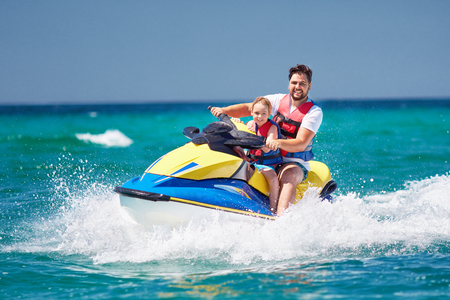 Photo for happy, excited family, father and son having fun on jet ski at summer vacation - Royalty Free Image