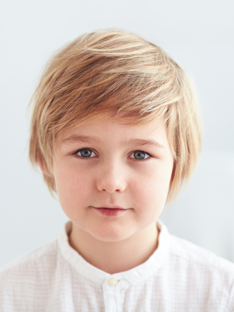 Foto de shoulder portrait of cute, nine years old kid, boy for id card - Imagen libre de derechos