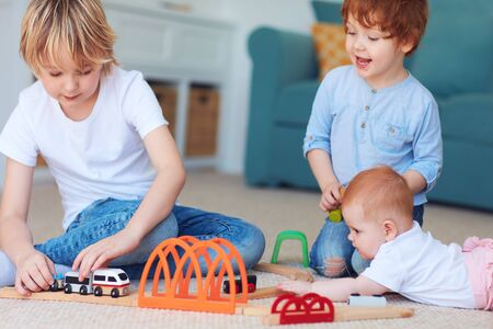 Photo for cute kids, siblings playing toys together on the carpet at home - Royalty Free Image