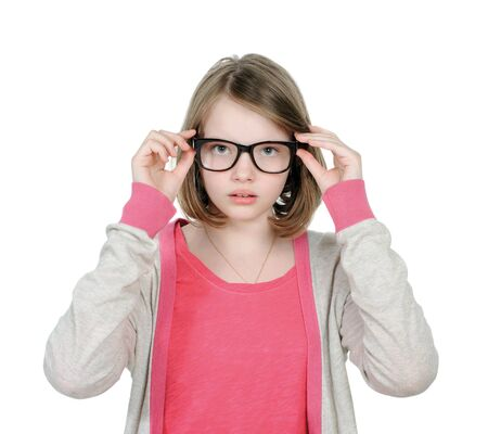 Cute young girl wears glasses to view.