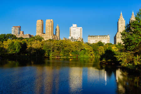 Photo for Skyline with apartment skyscrapers over lake in Central Park in midtown Manhattan in New York City - Royalty Free Image