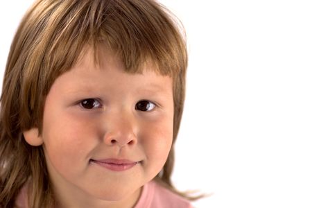 Portrait of Smiling kid wearing pink closes looking at you isolated on white