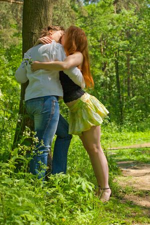 Two Girlfriends kissing in summer forest vacations