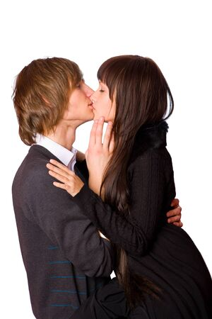 Young beautiful couple kissing isolated on white