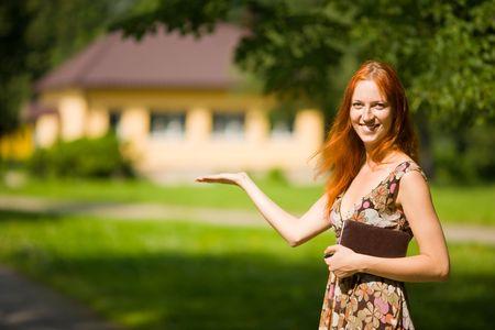 Photo pour Real Estate Agent smiles near new house for sale - image libre de droit