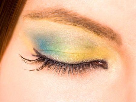 Macro shot of closed female eye with clorful make up