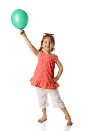 Photo for Cheerful five year girl holding balloon isolated on white - Royalty Free Image