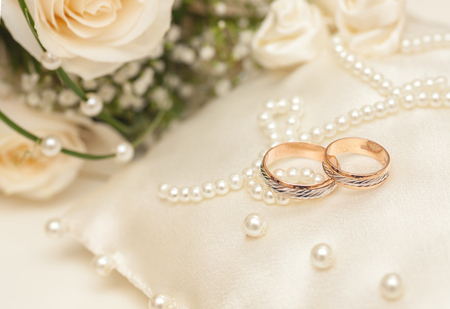 Photo for Two Golden Wedding Rings with purls on pillow - Royalty Free Image