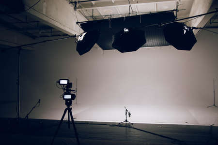 Photo for The interior of a large modern video studio with professional equipment prepared for work. Camera in the foreground - Royalty Free Image
