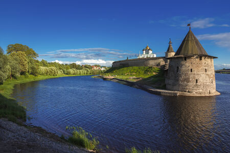 Stone tower and Pskov Kremlin fortress wall at the confluence of two rivers, Russia