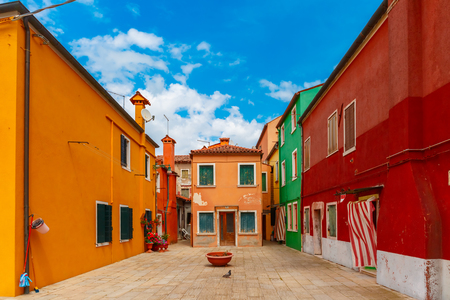 Patio with colorful houses on the famous island Burano, Venice, Italy